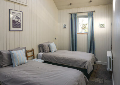 Twin beds in the Retreat Barn