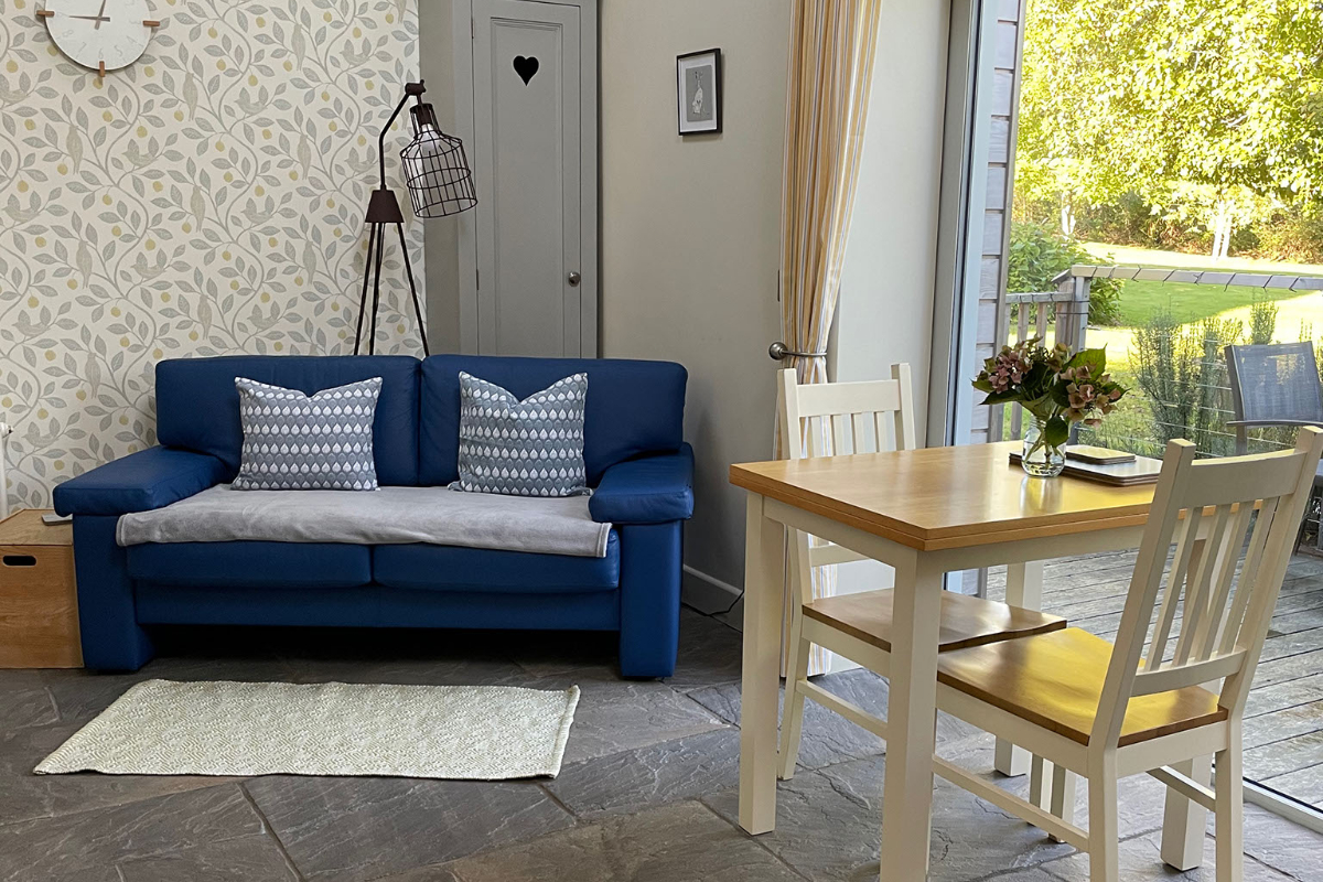 Retreat to the Hills Sofa with a view of the gardens